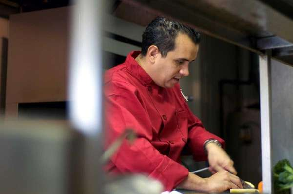 Chef Maicol Chacon prepares an order in the