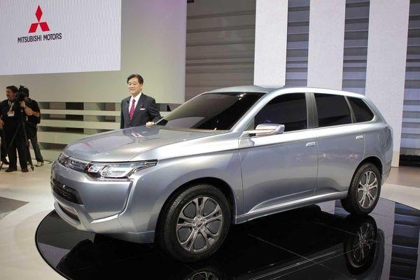 Mitsubishi Motors Corp. President Osamu Masuko poses with