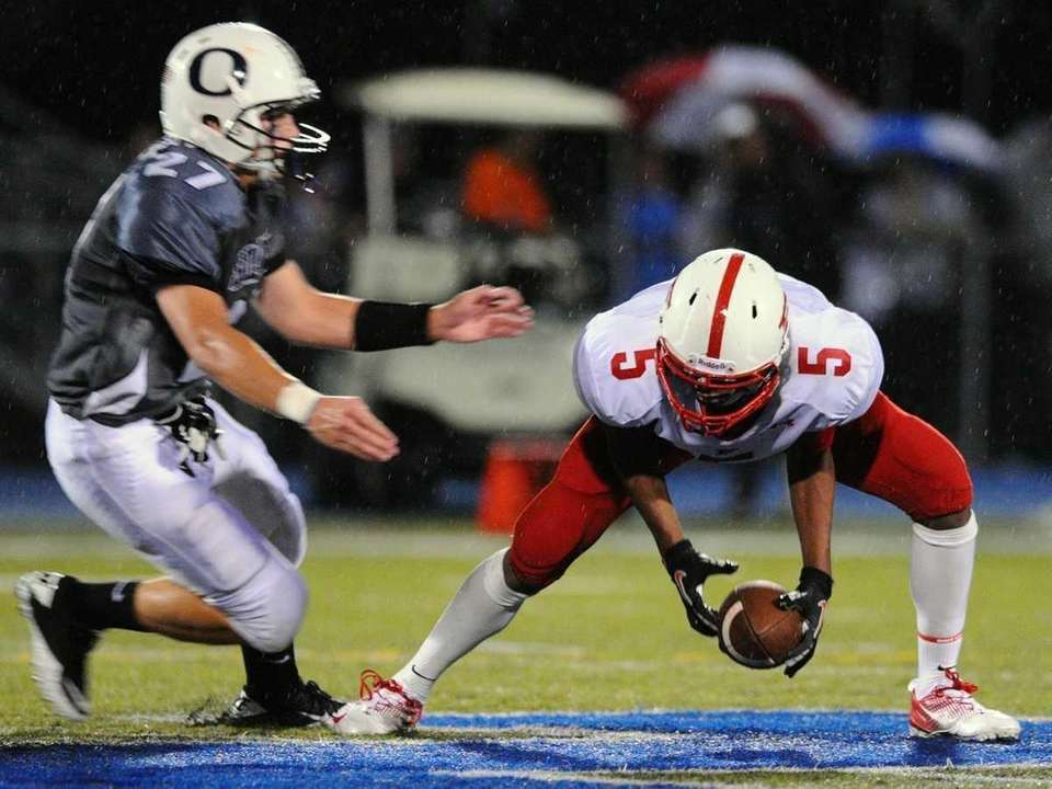Freeport's Jere Brown, right, protects the ball after