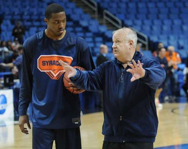 Syracuse assistant coach Bernie Fine working with DaShonte