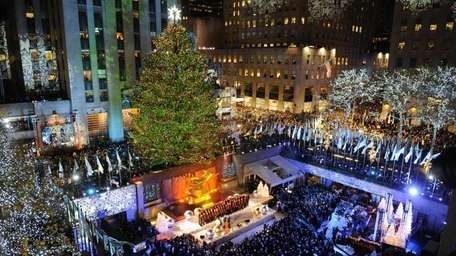 The 74-foot-tall Rockefeller Center Christmas Tree is lit