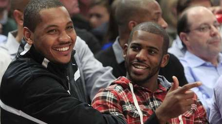 Carmelo Anthony, left, and Chris Paul talk during