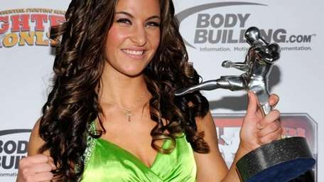 Strikeforce women's MMA champion Miesha Tate holds the