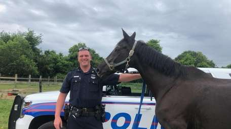 Highway Patrol Officer Matthew Siesto with Oppie, who