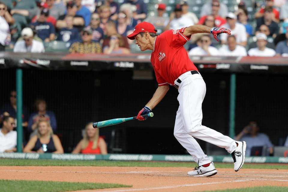 Dr. Oz hits during the MLB All-Star Legends