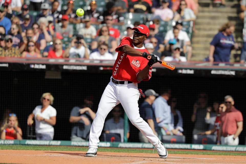 Kenny Lofton hits during the MLB All-Star Legends