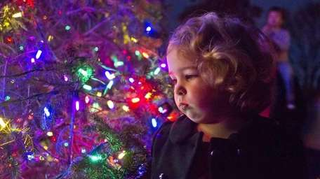 Madison Smith, 2, of Southold gets an up-close