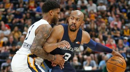 The Jazz's Justin Wright-Foreman guards the Grizzlies' Jevon