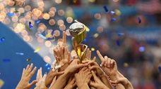 U.S. players celebrate after winning the Women's World