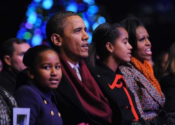President Barack Obama (2nd L) and his family