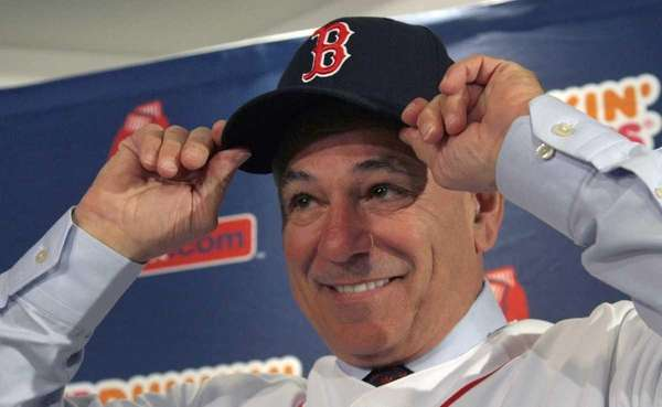 Boston Red Sox manager Bobby Valentine puts on