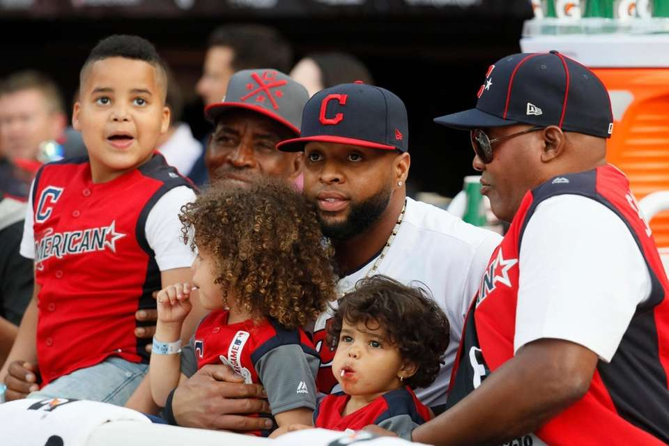 Carlos Santana, of the Cleveland Indians, watches with