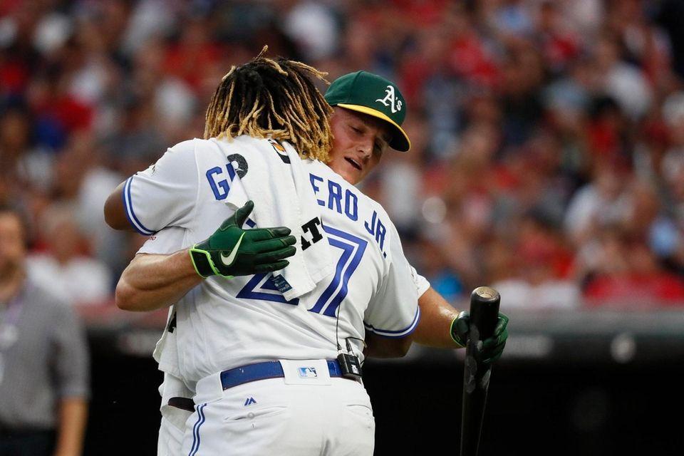 Vladimir Guerrero Jr., Toronto Blue Jays, hugs Matt