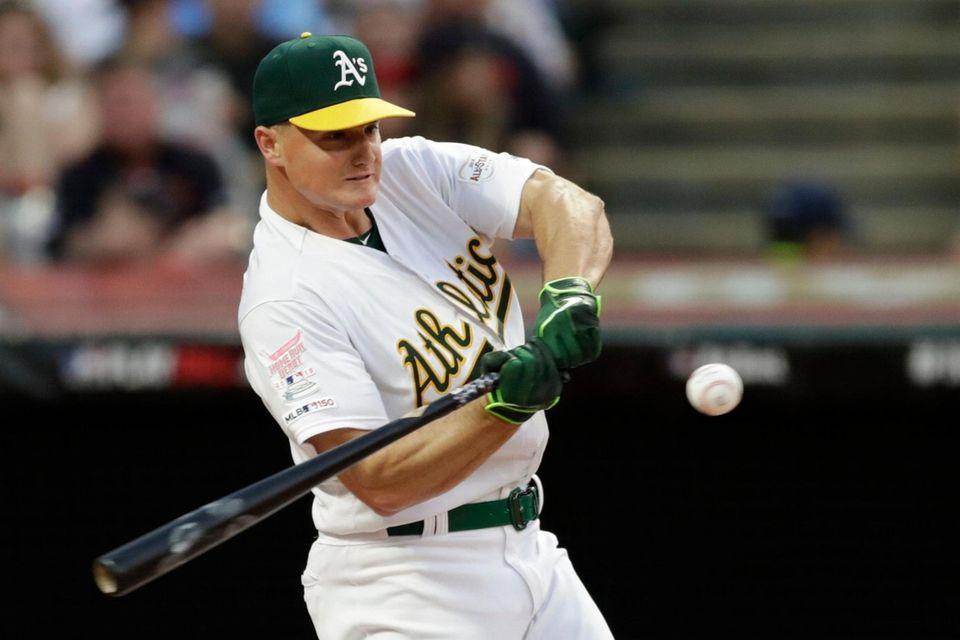 Matt Chapman, of the Oakland Athletics, hits during