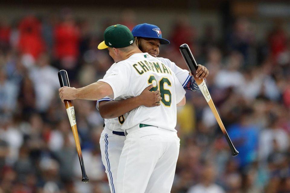 Matt Chapman, of the Oakland Athletics, hugs Vladimir