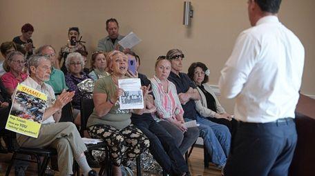 Immigration activists speak to Rep. Thomas Suozzi during