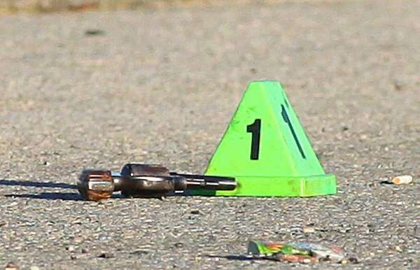 A cone marks the gun at the scene