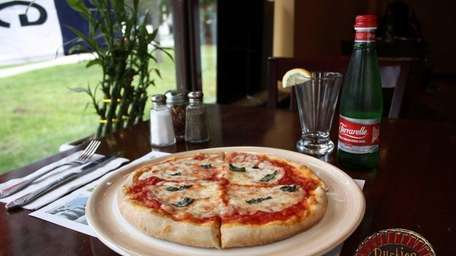 Pizza at Rustica Brick Oven Cafe in Garden