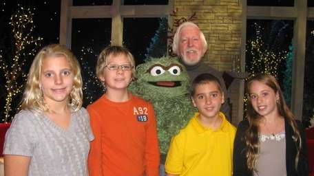 Oscar the Grouch and Carol Spinney (back) with