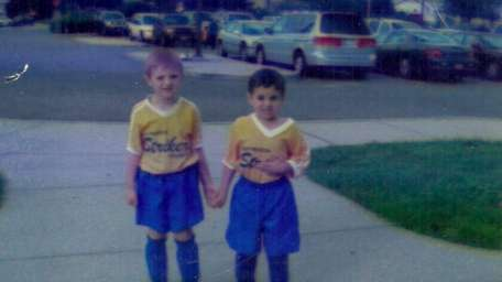 James Wallace, 4, left, and his brother, Joey,