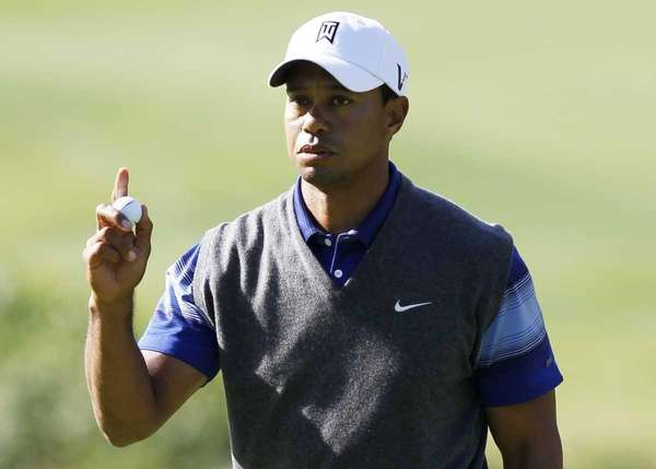 Tiger Woods acknowledges the crowd after making an