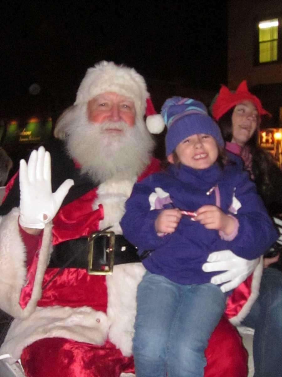 Isabella Capizzi, 6, of Babylon sits on Santa