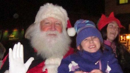 Isabella Capizzi, 6, of Babylon sits on Santa
