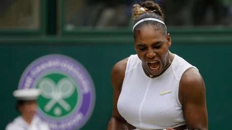 Serena Williams celebrates after winning a point against