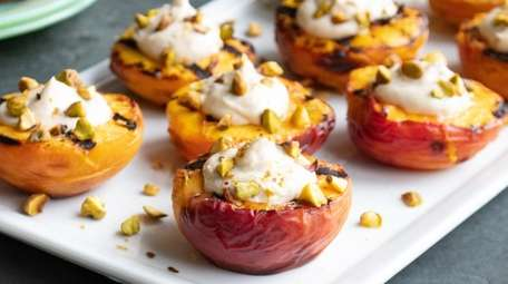 Grilled peaches filled with tahini-yogurt and topped with