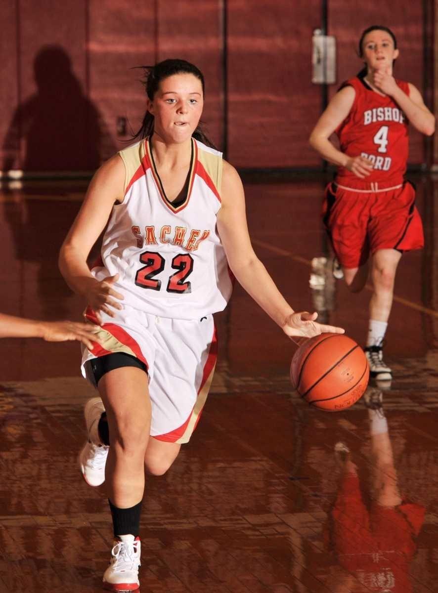 Sachem East 's #22 Megan Dougherty dribbles downcourt
