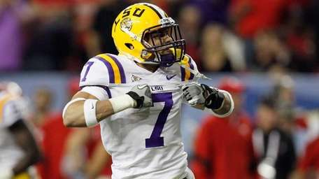 Tyrann Mathieu of the LSU Tigers reacts after