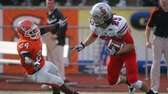 Stony Brook returner Jordan Gush, right, gets around