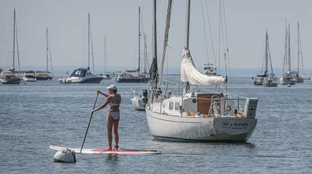Diana Feirstein of Coram paddles her standup paddleboard