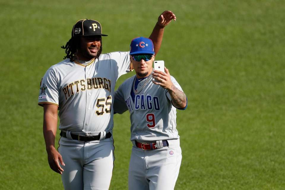 Josh Bell, of the Pittsburgh Pirates, and Javier