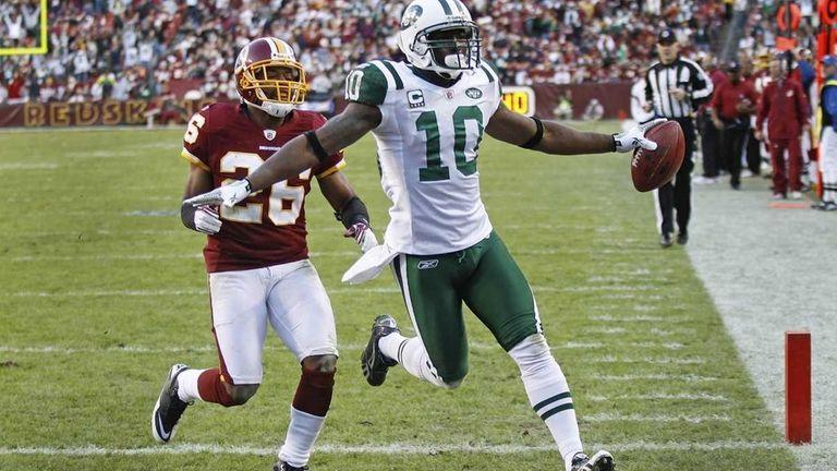 New York Jets wide receiver Santonio Holmes celebrates