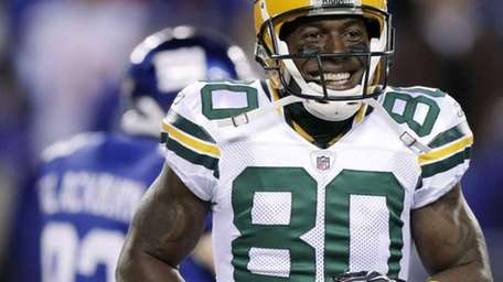 Green Bay Packers' Donald Driver celebrates after scoring