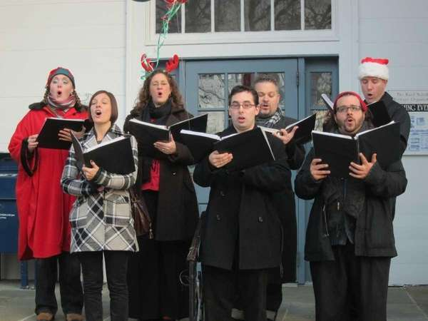 Carolers sang Christmas music at the Ward Melville