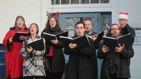 Carolers sang Christmas music at the Ward Melville