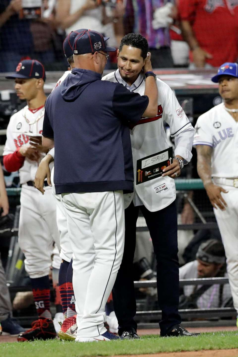 Cleveland Indians manager Terry Francona, left, hugs Indians