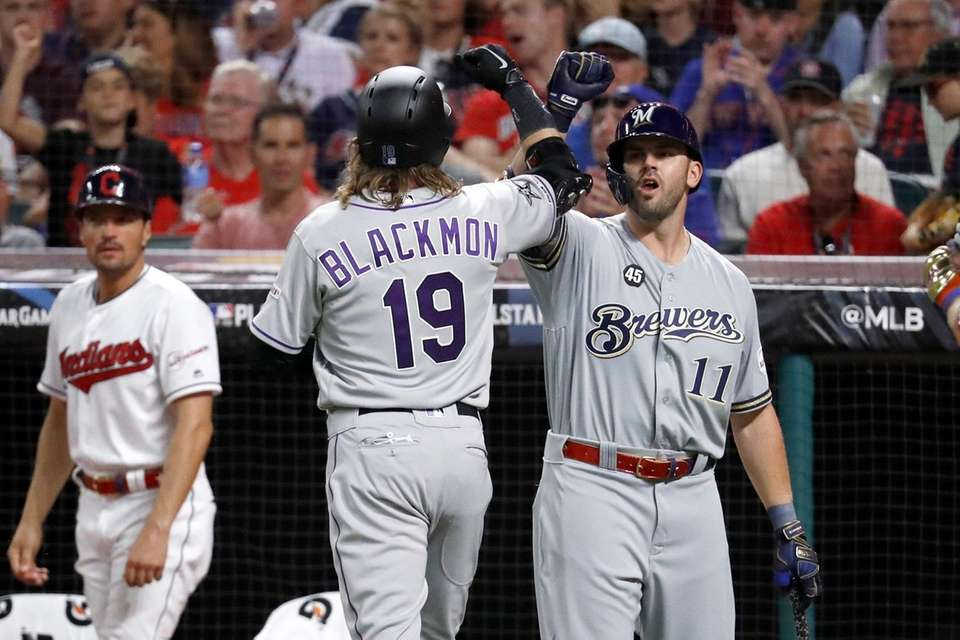 National League's Charlie Blackmon (19), of the Colorado