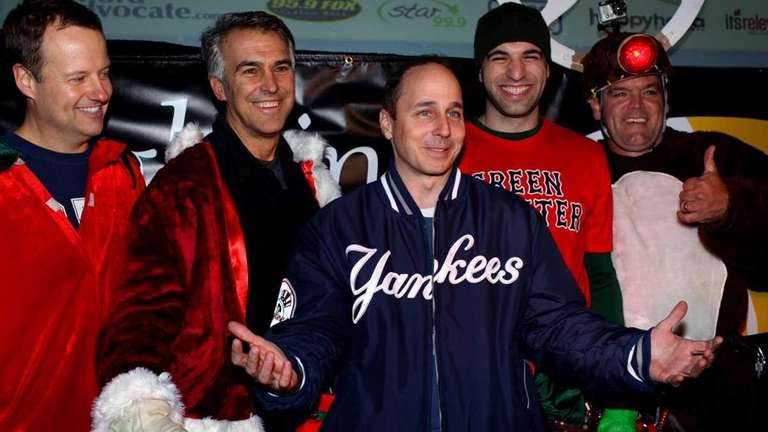 Brian Cashman poses with the rappel team he