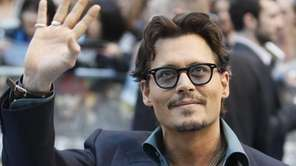 US actor Johnny Depp poses for the cameras