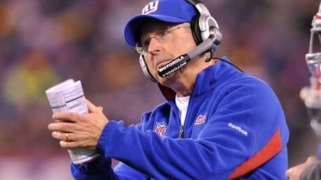 Tom Coughlin viewing the last-minute action during the