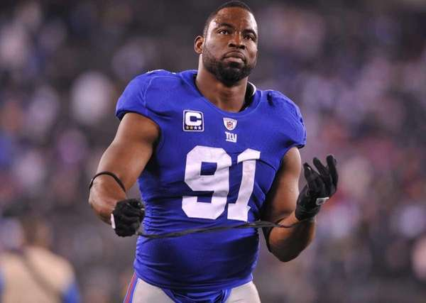Justin Tuck unwraps after the Giants lost to