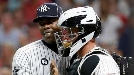 Yankees bullpen ace Aroldis Chapman, left, closed it