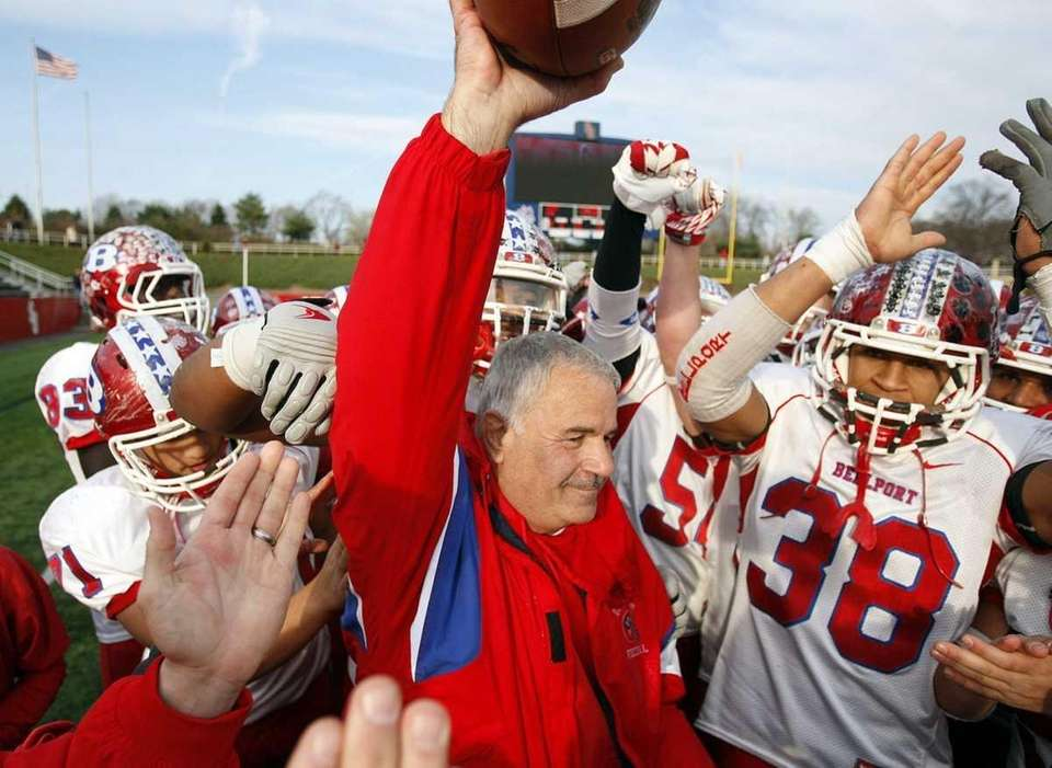 Bellport head coach Joe Cipp holds up the