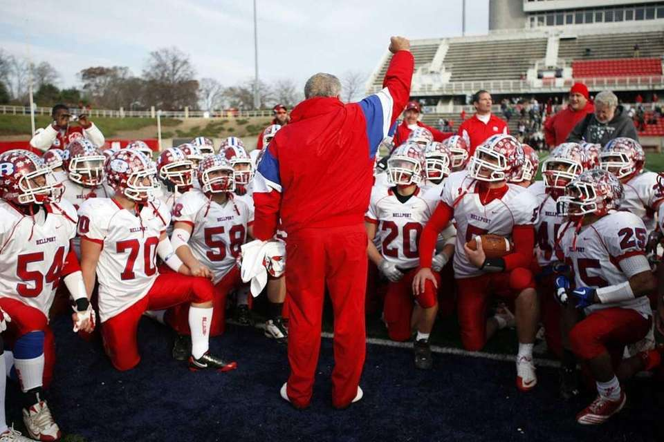 Bellport head coach Joe Cipp rallies his team