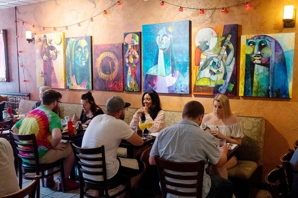 Patrons dine together in the dining room of