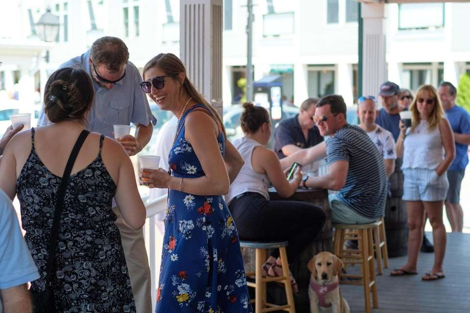 Patrons sip craft beer and mingle on the
