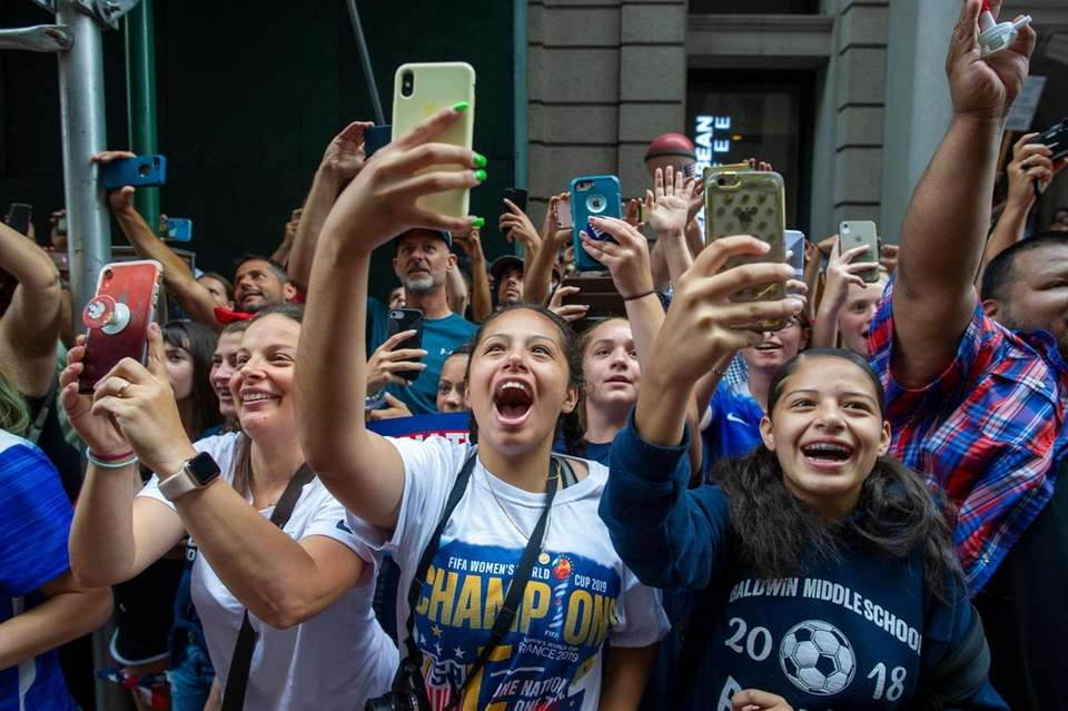 Fans take pictures and cheer on U.S. women's